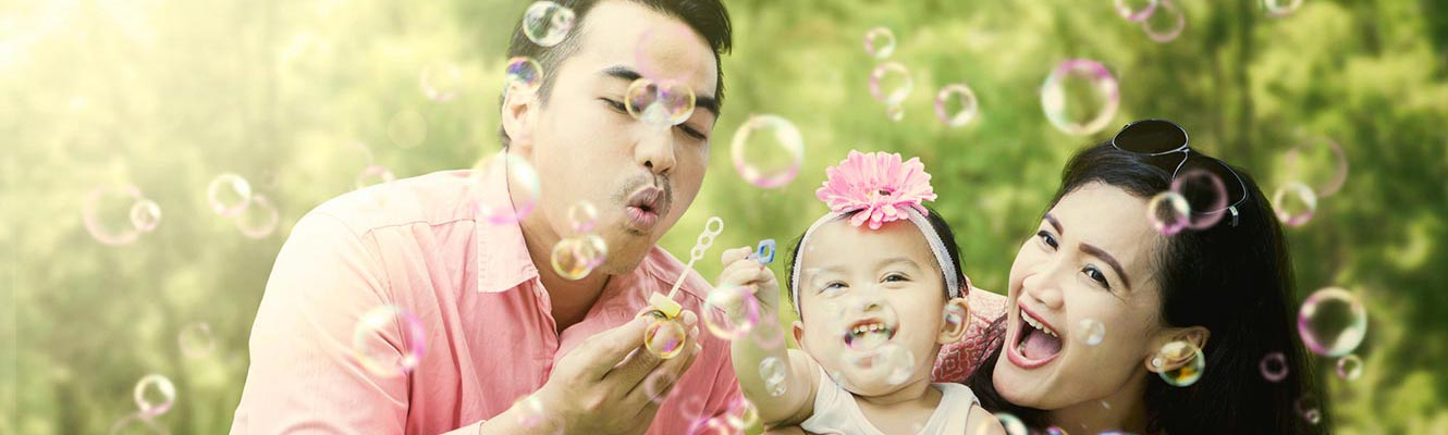 Young family blowing bubbles